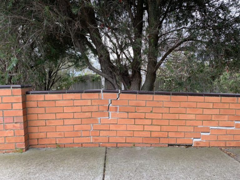 """Photo of a brick fence needing brick repairs in Toowoomba - Bricklayers in Toowoomba performing repairs on a brick fence - Damaged brick fence that requires repair work in Toowoomba """