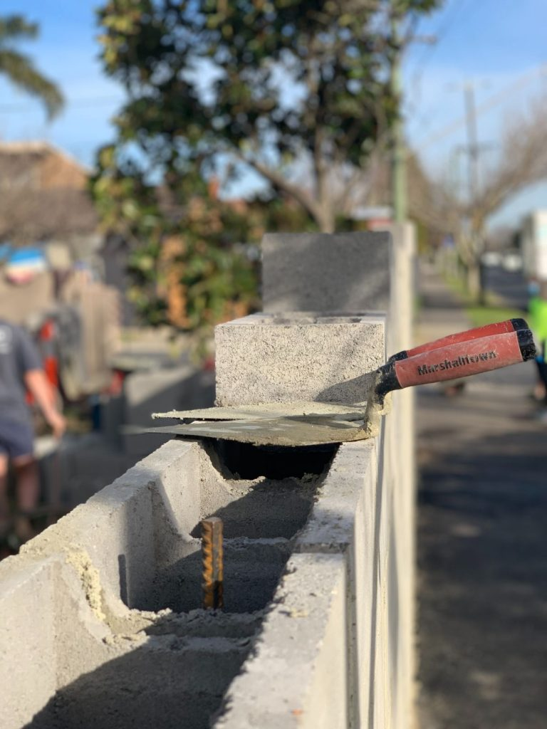 A feature brick fence built by Toowoomba Bricklayers in Rangeville, Toowoomba - Toowoomba Bricklayers working in Middle Ridge on a brick fence - Bricklayers in Toowoomba working on a block fence ""