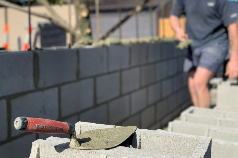 A feature brick fence built by Toowoomba Bricklayers in Rangeville, Toowoomba - Toowoomba Bricklayers working in Middle Ridge on a brick fence - Bricklayers in Toowoomba working on a block fence